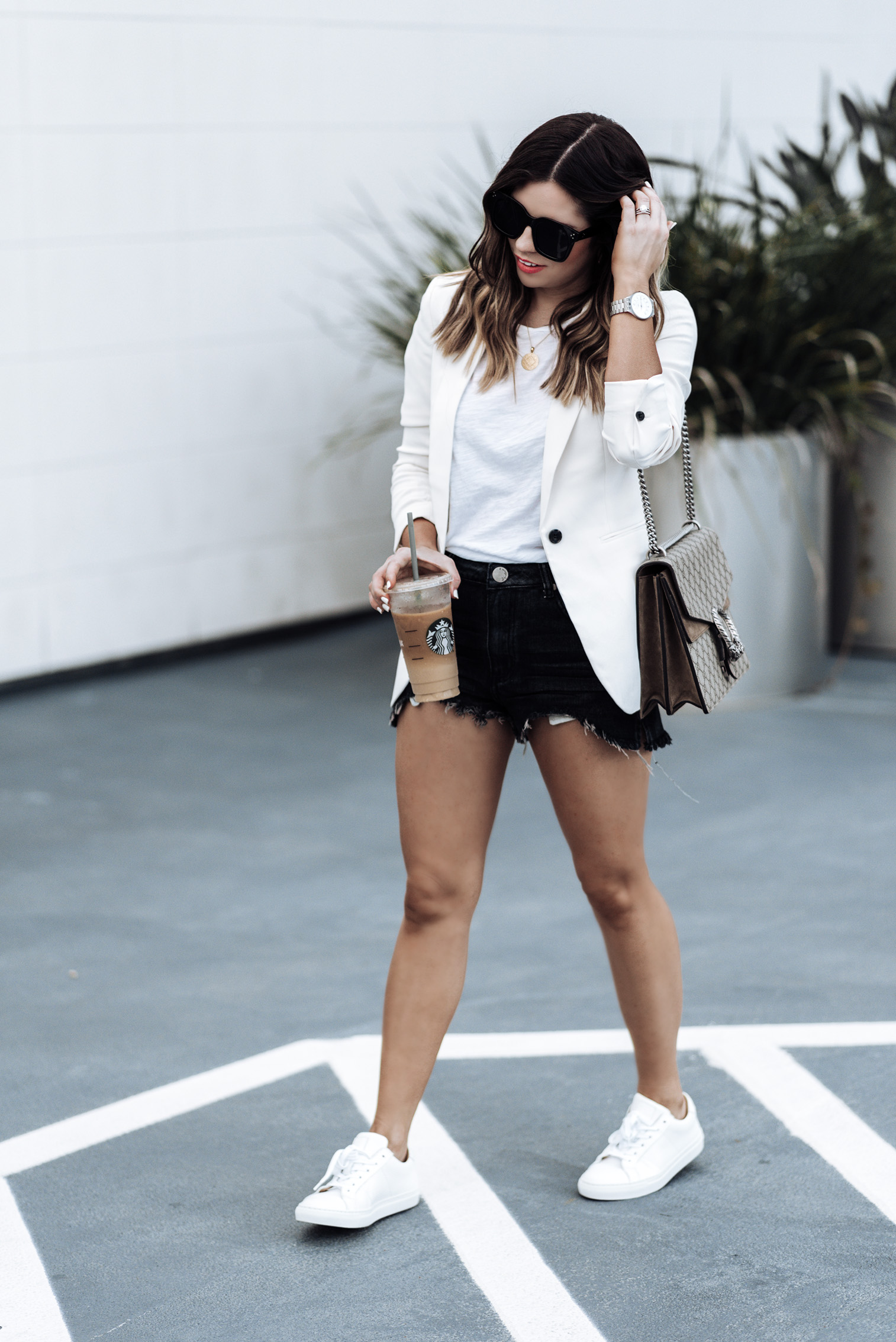 Tiffany Jais Houston fashion and lifestyle blogger |Transitional fall pieces | White Blazer from H&M (similar style here) | Denim Shorts (Similar) | Gucci Dionysus bag | {C/O} Greats sneakers |