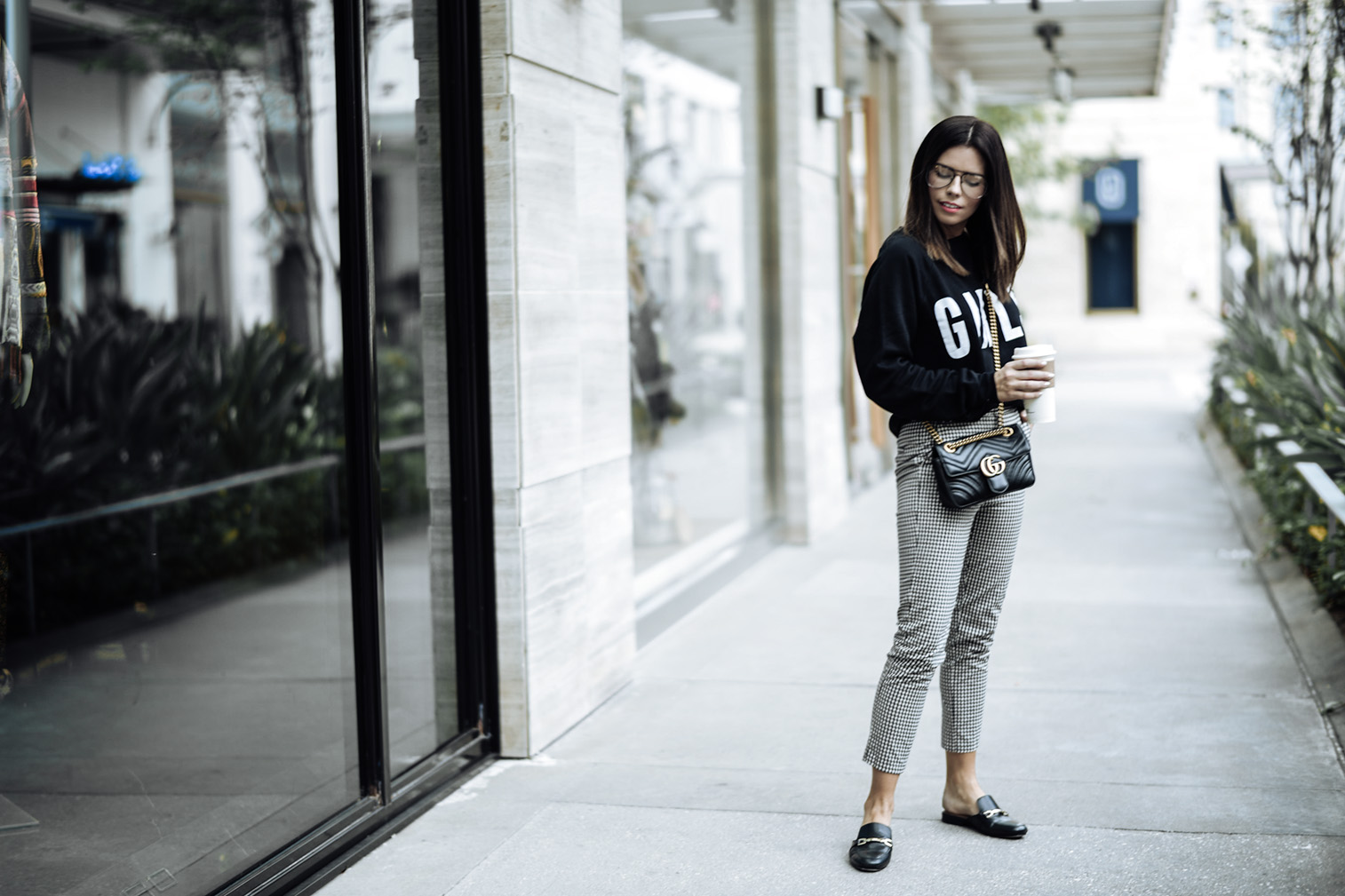 Tiffany Jais fashion and lifestyle blogger of Flaunt and Center | Houston fashion blogger | Streetstyle blog | Brunette The Label Girls sweatshirt {C/O For bloggers Only} | Gingham pants {Currently 50% off with code get $50} | Black readers | Gucci marmot bag in black |