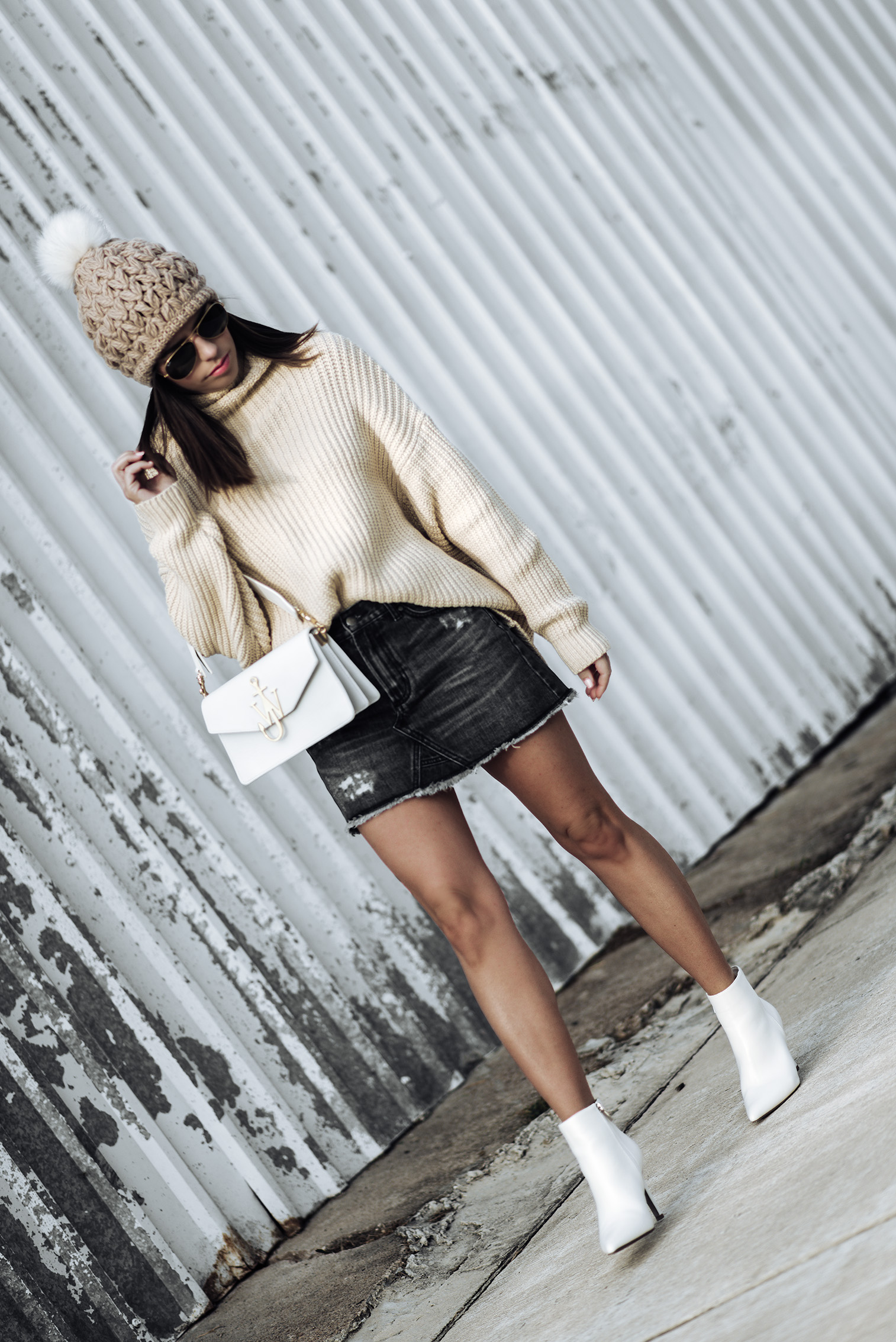 All white accessories |Free People swim too deep sweater | Evidnt denim skirt | White ankle boots (similar) | Pom pom beanie (this years version) | J.W. Anderson logo bag in white |Tiffany Jais fashion and lifestyle blogger of Flaunt and Center | Houston fashion blogger | Straw handbag Trend | Streetstyle blog #streetstyle #sweateroutfits #denimskirtoutfits #falloutfits2017 #falloutfits