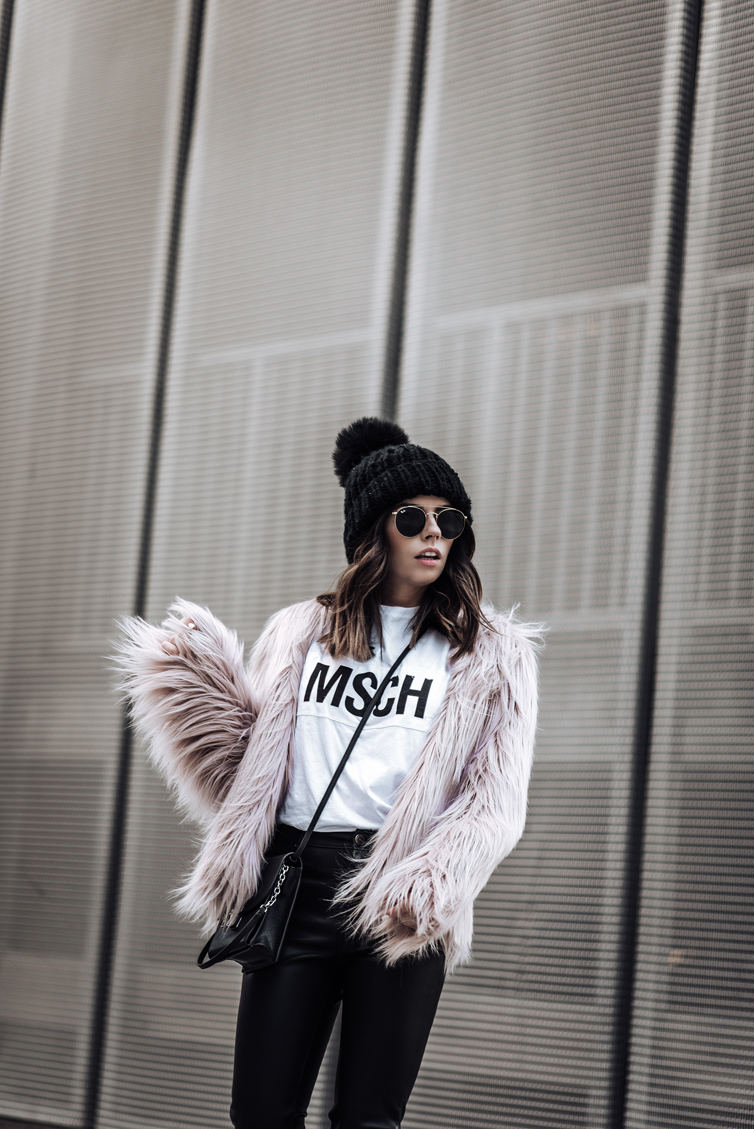 Click to shop the look: Pop of pink | Pink Unreal Fur Coat | MSCH T Shirt | The Principle Mid Rise Vegan Leather Skinny Jeans | {C/O} Henri Bendle Peru Bag | Vans Old Skool sneakers #streetstyle