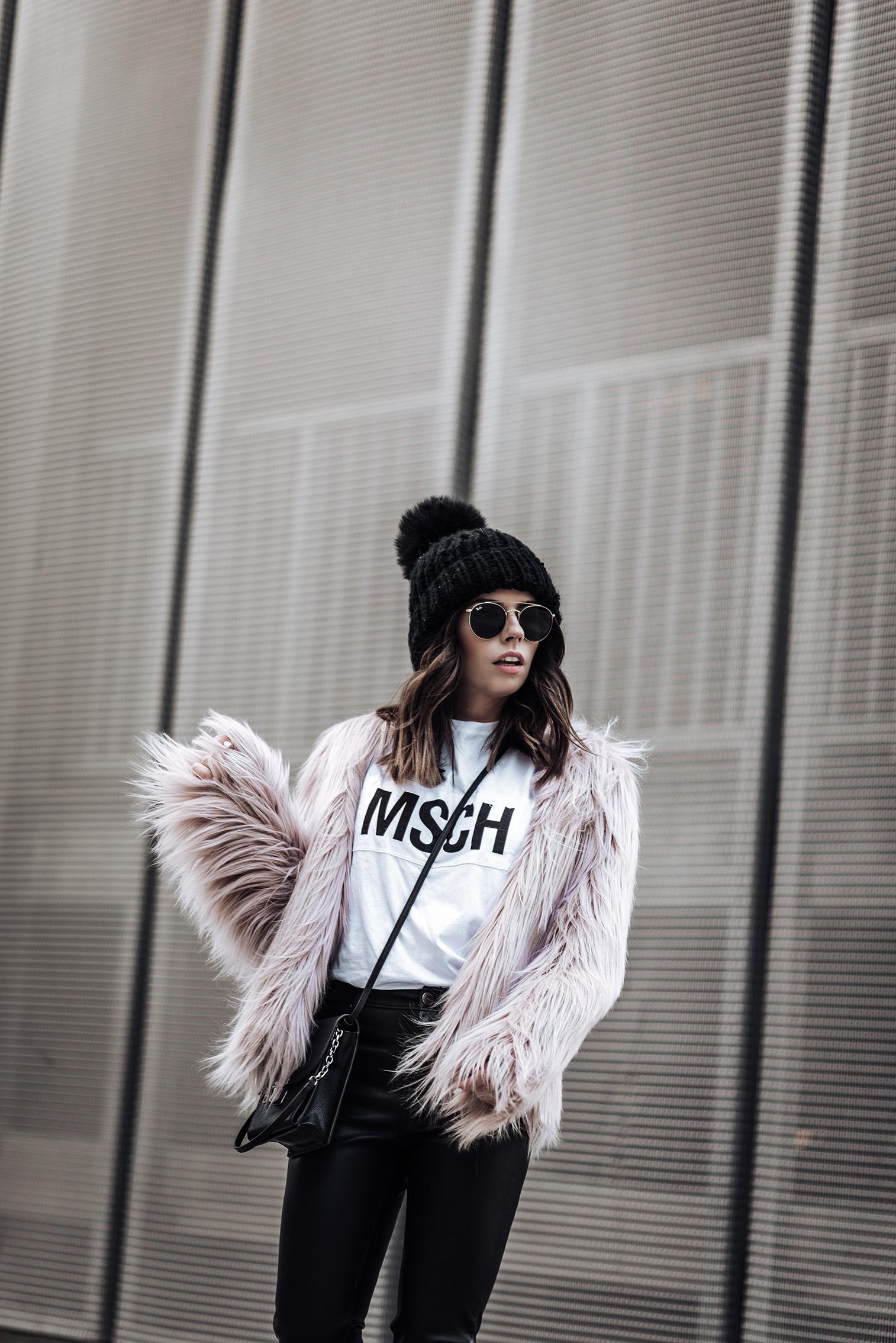 Click to shop the look: Pop of pink | Pink Unreal Fur Coat | MSCH T Shirt | The Principle Mid Rise Vegan Leather Skinny Jeans | {C/O} Henri Bendle Peru Bag | Vans Old Skool sneakers #streetstyle