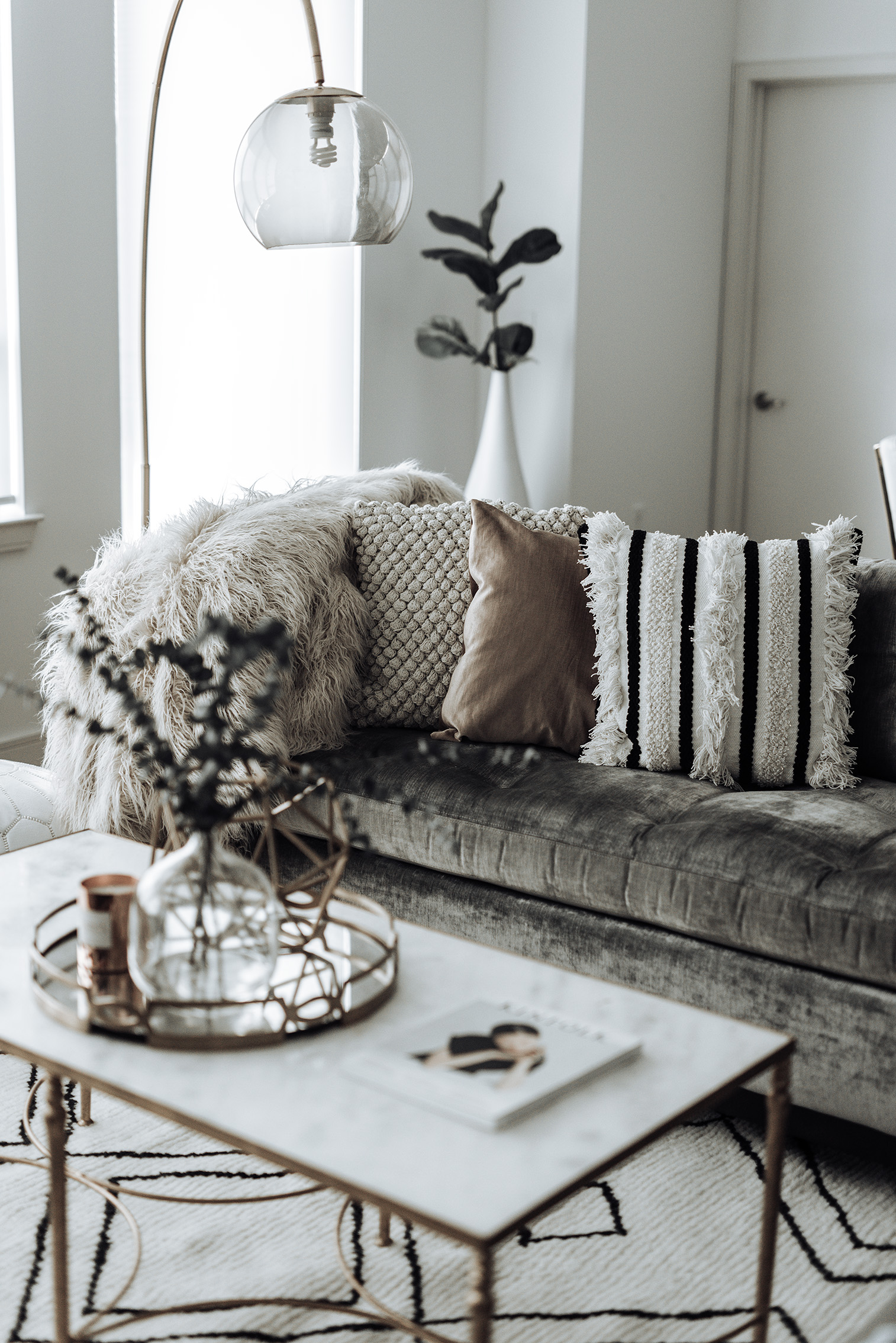 Click to shop | Family room update | Vega Moroccan Rug | Marble coffee table (similar) | White Leather Pouf Ottoman (on sale!)  | Textured Indra Pillow | Glass Vase | Blush Cotton Luster Velvet Pillow | | Marisa Throw Blanket | Pompom Pillow | Overarching Lamp