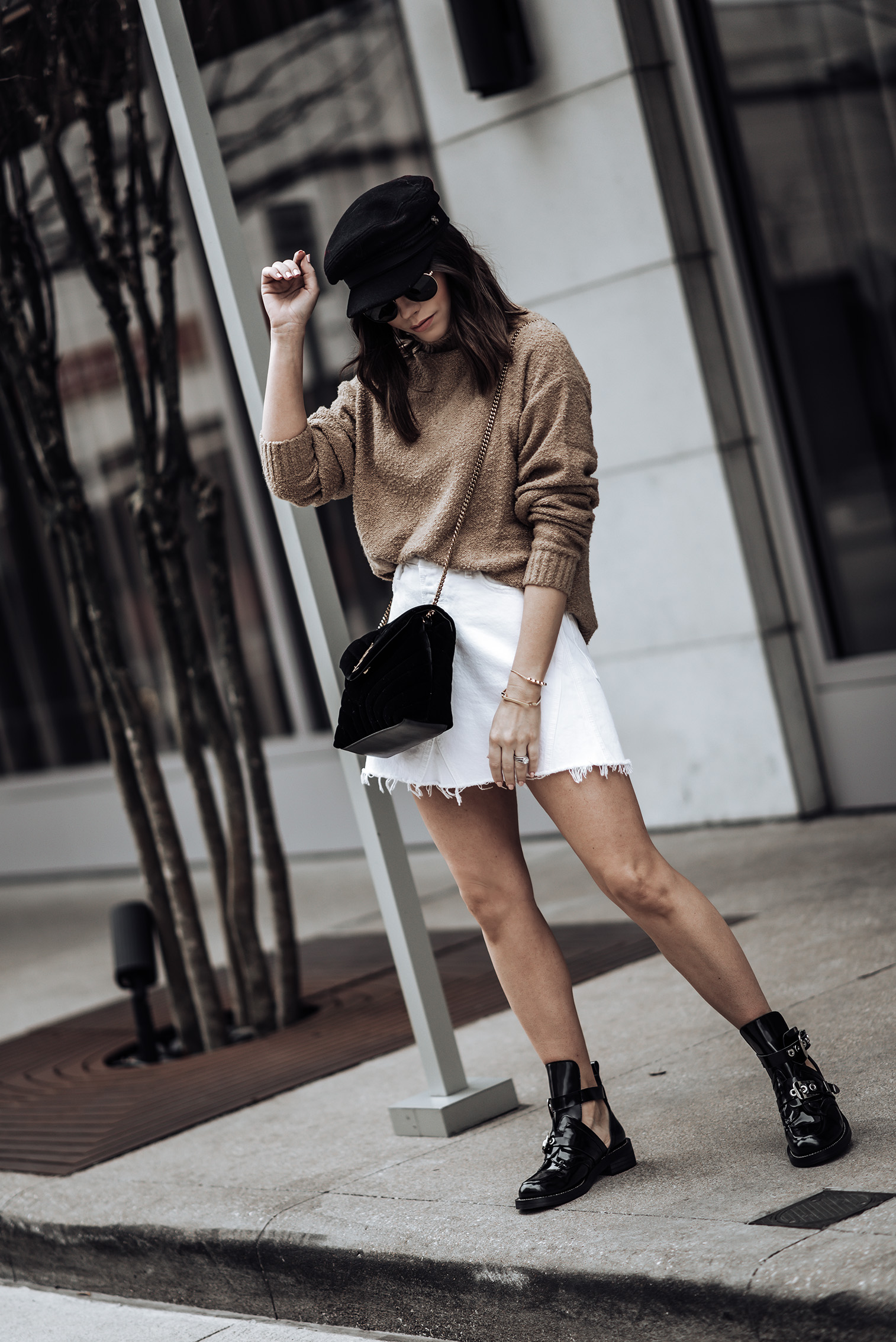 Combat boot trend | #streetstyle #blog #liketkit {C/O} GRLFRND Denim Eva A- Frame Skirt | {C/O} House of Harlow 1960 x REVOLVE Renee Pullover | Saint Laurent Small Black LouLou Velvet Bag | Bakers Cap (Similar) | Balenciaga boots Real vs. Steal)