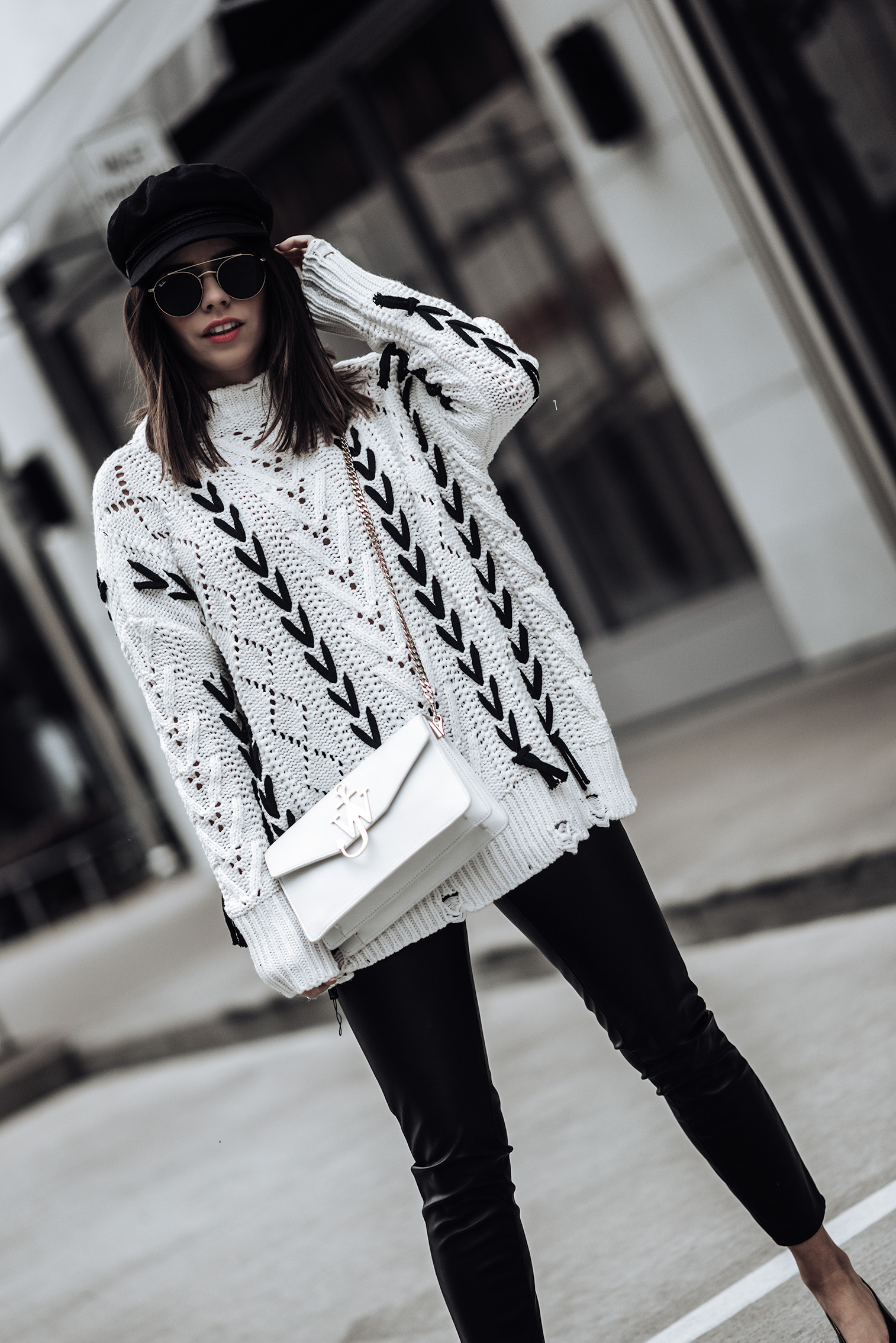 Lace up leisure open knit sweater {C/O} Chicwish | The principle mid rise vegan leather skinny pant | J.W. Anderson logo bag | Slingback heels | Fiddler cap | Ray-Ban 51 mm Sunglasses