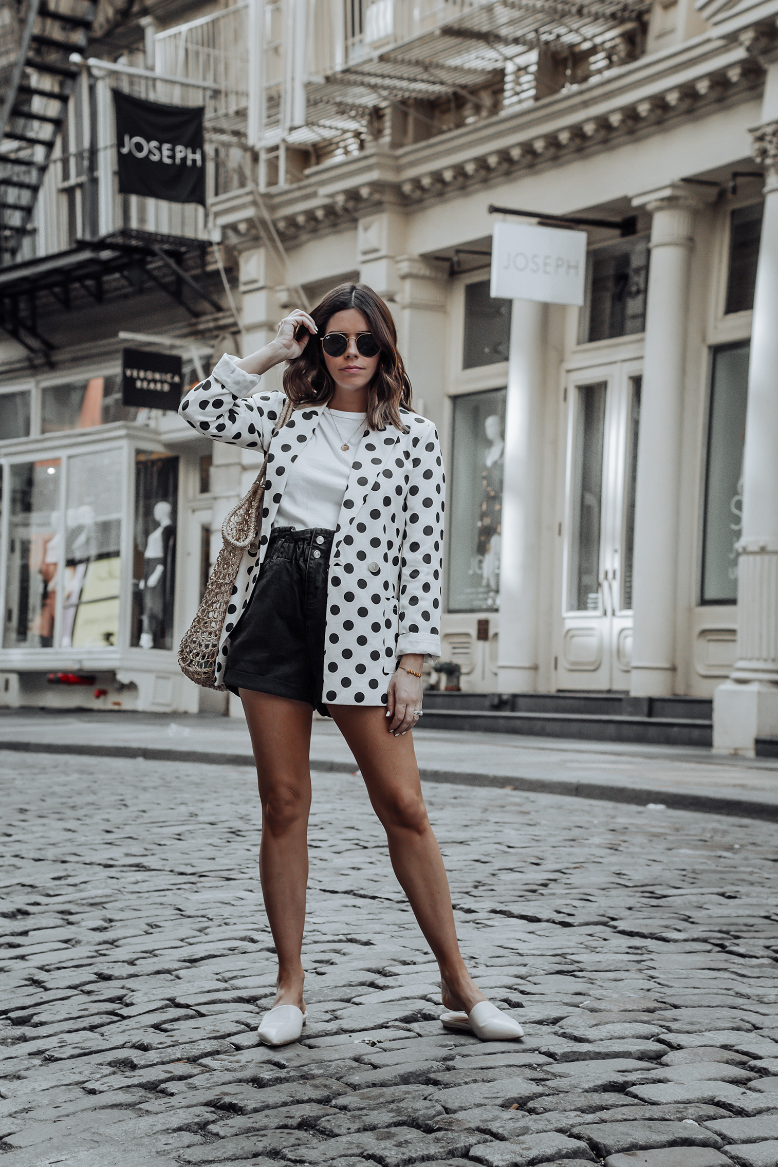 Linen spotted blazer   Click to shop the look: Black Paper Bag Shorts (similar)  Linen Spotted Jacket   Straw Tote bag (similar)   #liketkit #blazer #streetstyle #ootd #strawbag #topshop #casualfashion #nycblogger