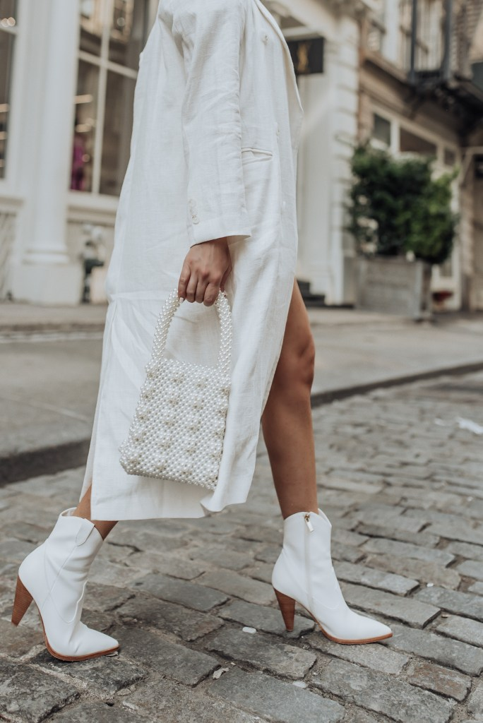 Tiffany Jais fashion and lifestyle blogger of Flaunt and Center | NYC fashion blogger | Straw handbag Trend | Streetstyle blog