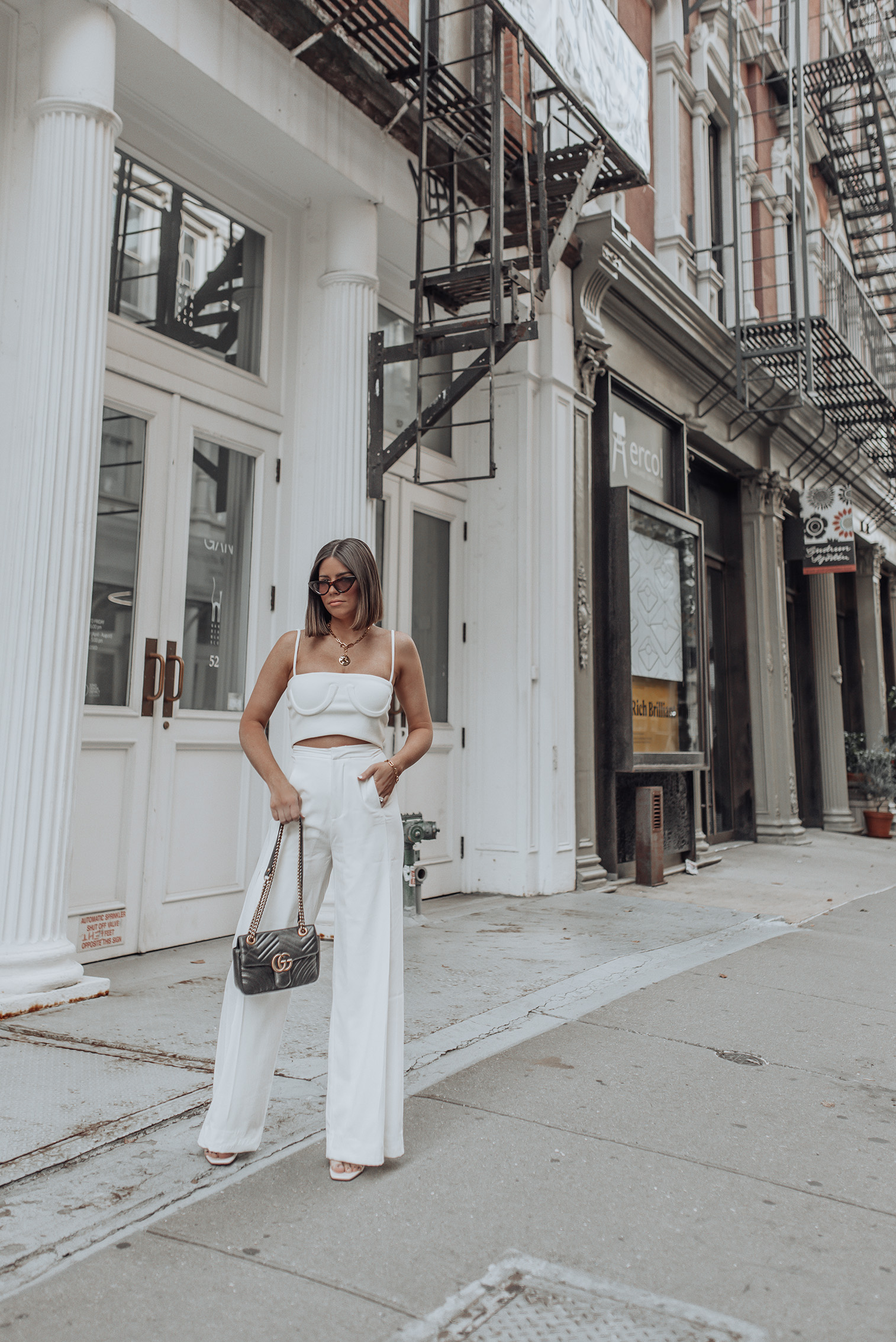 Orseund iris tube tank | White Pants | Gucci Bag Seriously obsessed with this ribbed knit tube tank by Orseund Iris! It's timeless and such a great staple you can style and wear over and over again. Also I love how well it pairs with white pants for a chic elevated look. #streetstyle #NYFW #allwhiteoutfit