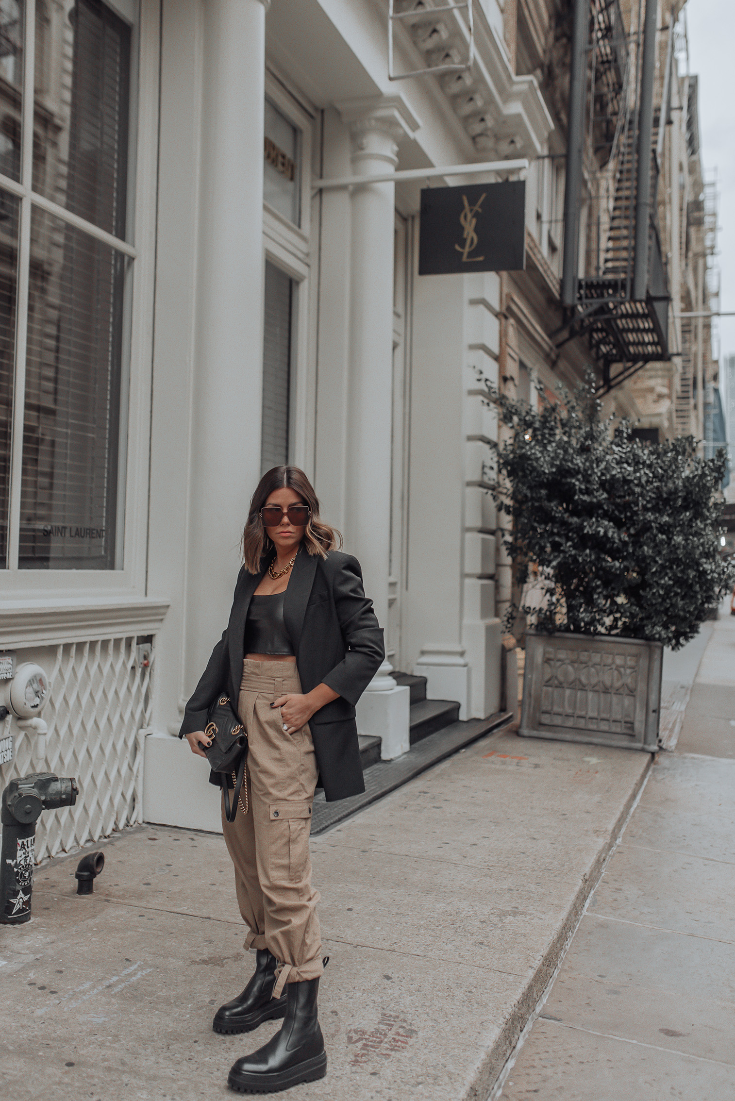 Pants (Zara) | Blazer (zara) | Faux Leather Crop Top | Gucci Bag NYFW 2020 has arrived! Getting so much inspiration this year and one of the trends I'm most into at the moment is combat boots! I seriously wear them all the time now! They don't hurt my feet and add an extra vibe to just about every look. Totally into comfort and edge, as always!