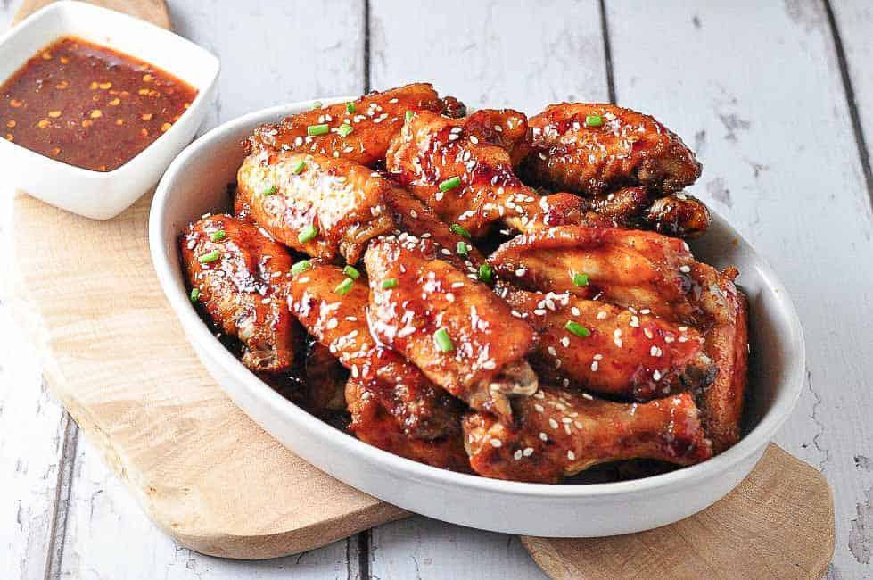 Chipotle Honey-Mustard Glazed Chicken Wings in a bowl on a serving board