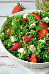 Tender baby kale, fresh strawberries, feta cheese and pumpkin seeds are tossed with a cheerful poppy seed dressing in this recipe for Strawberry Kale Salad.