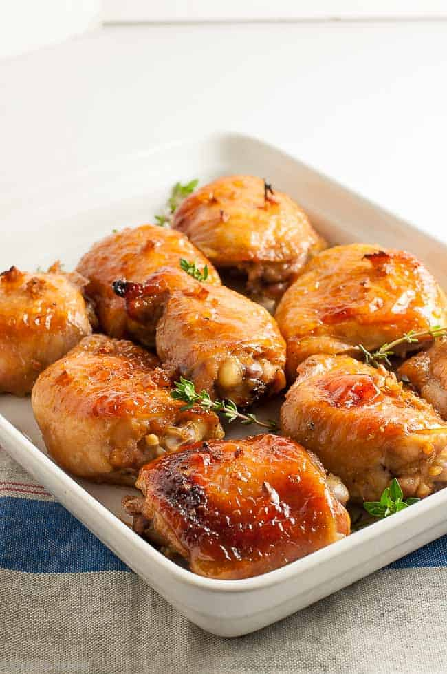 Bake these sweet 'n salty succulent paleo Maple Garlic Glazed Chicken thighs next time you need a quick and easy dinner.