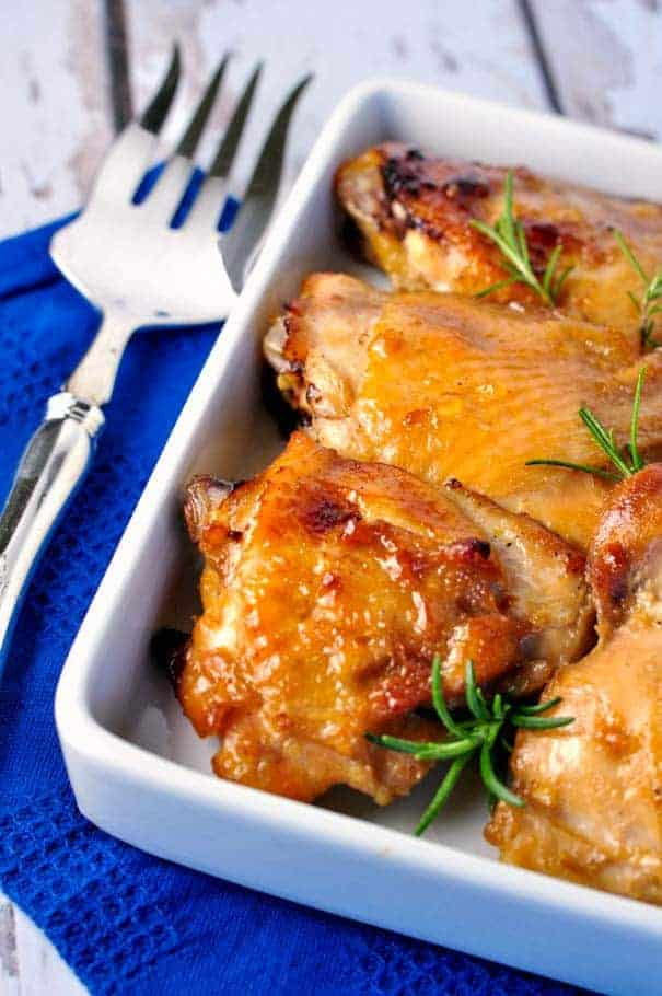 Maple Garlic Glazed Chicken Thighs with a serving fork