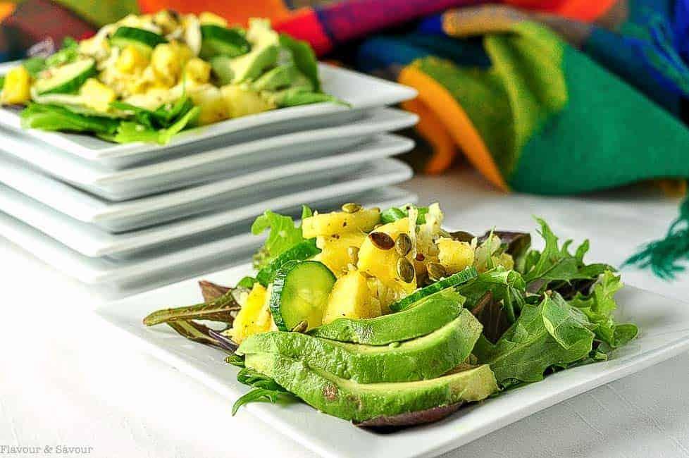 Paleo Pineapple Jicama Salad with avocado on white square plate