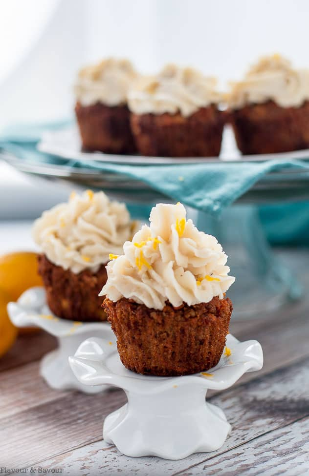 Paleo Carrot Cake Cupcakes with Coconut Butter Frosting on a cupcake pedestal