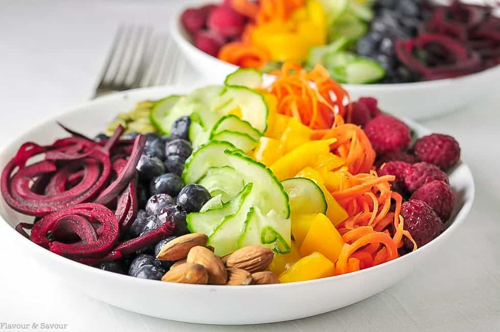 Rainbow Detox Salad. Raspberries, peppers, cucumber, blueberries and beets lined up in the colours of the rainbow.