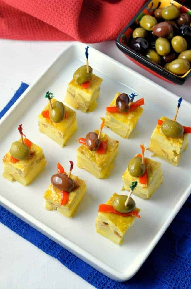 Get this quick and easy recipe for Tortilla Española, or Spanish Tortilla. These tapas are perfect for a tapa party, or for breakfast, lunch or dinner! Made with just 4 ingredients, this one hasn't failed me yet!