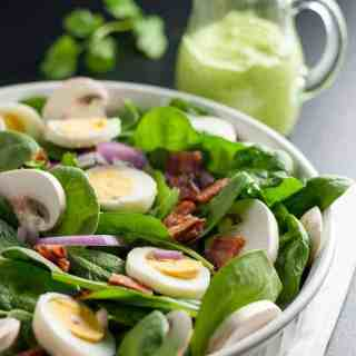 Classic Spinach Salad with Creamy Avocado Dressing. Love spinach salad but hate the high-fat buttermilk dressing? Try this updated paleo spinach salad with creamy dairy-free avocado dressing.