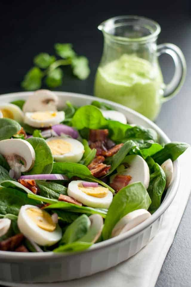 Classic Spinach Salad with Creamy Avocado Dressing. Love spinach salad but hate the high-fat buttermilk dressing? Try this updated paleo spinach salad with creamy dairy-free avocado dressing.A beautiful spring salad.