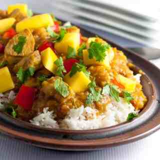 Sweet mangoes, spicy peppers and fresh lime combine to make this Slow Cooker Thai Mango Chicken a family favourite. Paleo and gluten-free. www.flavourandsavour.com