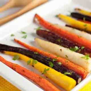 Easy Roasted Carrots with Honey-Ginger Glaze. A quick and easy side dish with bright flavours from fresh ginger and chili flakes.