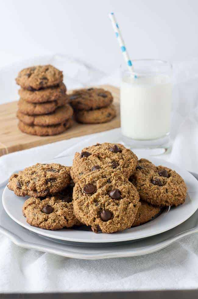 My Favourite Chocolate Chip Cookies on a plate with a glass of milk