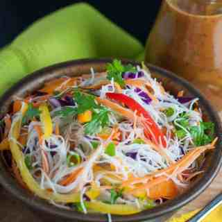 Crisp peppers, cabbage, carrots and cucumber, and crunchy peanuts are all tossed together with rice vermicelli and a spicy Thai-style peanut sauce in this Super Crunchy Thai Noodle Salad.