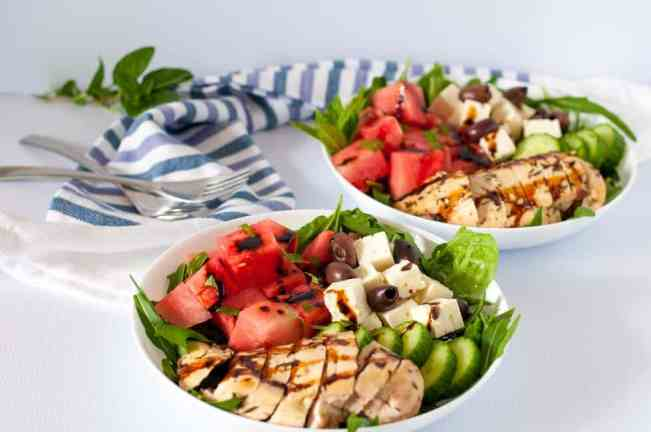 Greek Chicken Watermelon Feta Salad with Balsamic Dressing. Succulent chicken marinated with lemon and herbs, sweet watermelon, feta cheese and Kalamata olives all drizzled with balsamic reduction