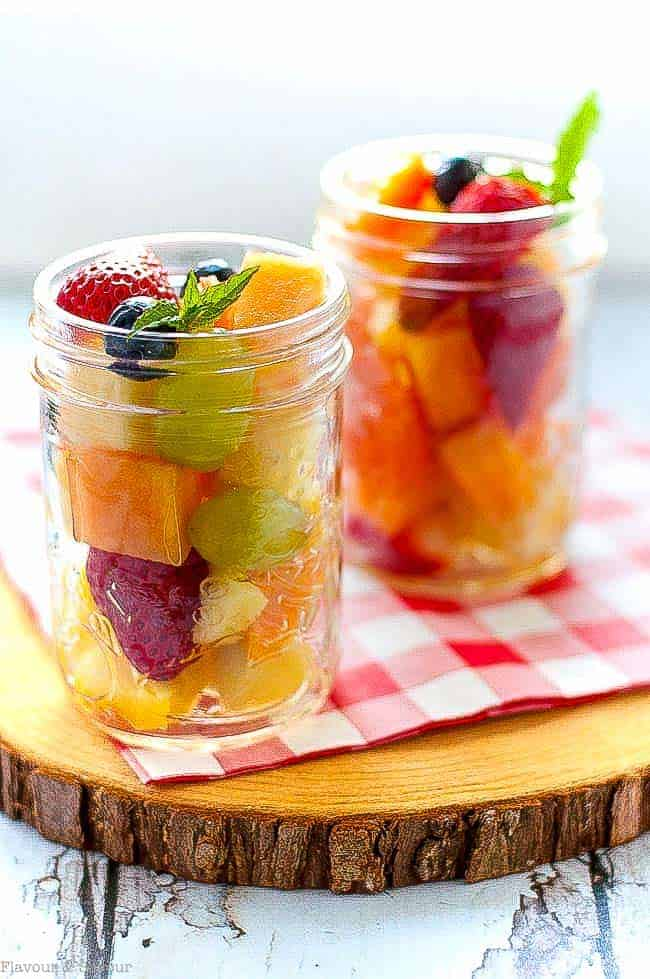 Mason Jar Boozy Tropical Fruit Salad. Fresh tropical fruit drizzled with Limoncello liqueur in a Mason jar makes a fancy dessert for your next picnic or camping trip! #camping #picnic #dessert #masonjar #fruitsalad #Limoncello