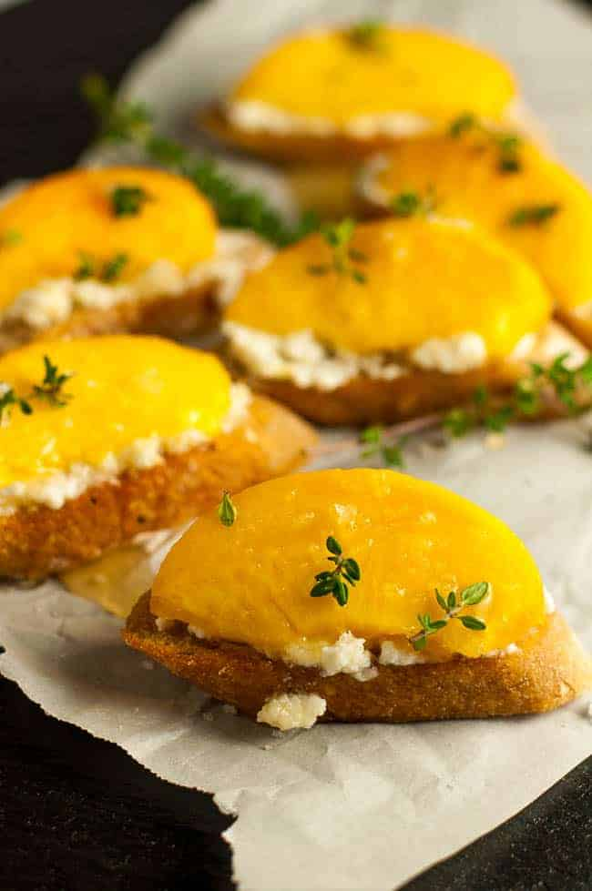 This Lemon Ricotta Crostini with Honeyed Peaches is so simple, but it's insanely delicious! Smear some creamy lemon ricotta cheese on a thin slice of toasted baguette, top it with a slice of fresh, juicy peach, drizzle it all with honey and sprinkle with tiny thyme leaves.