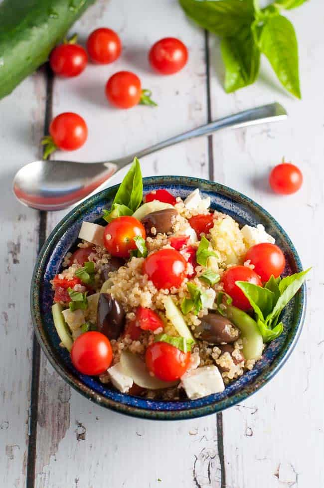 This garden fresh Mediterranean Quinoa Salad with Feta and Lemon Dressing makes a protein-rich summertime meal-in-a-bowl! Combine quinoa, tomatoes, cucumbers, Kalamata olives and fresh basil to make this gluten-free salad.