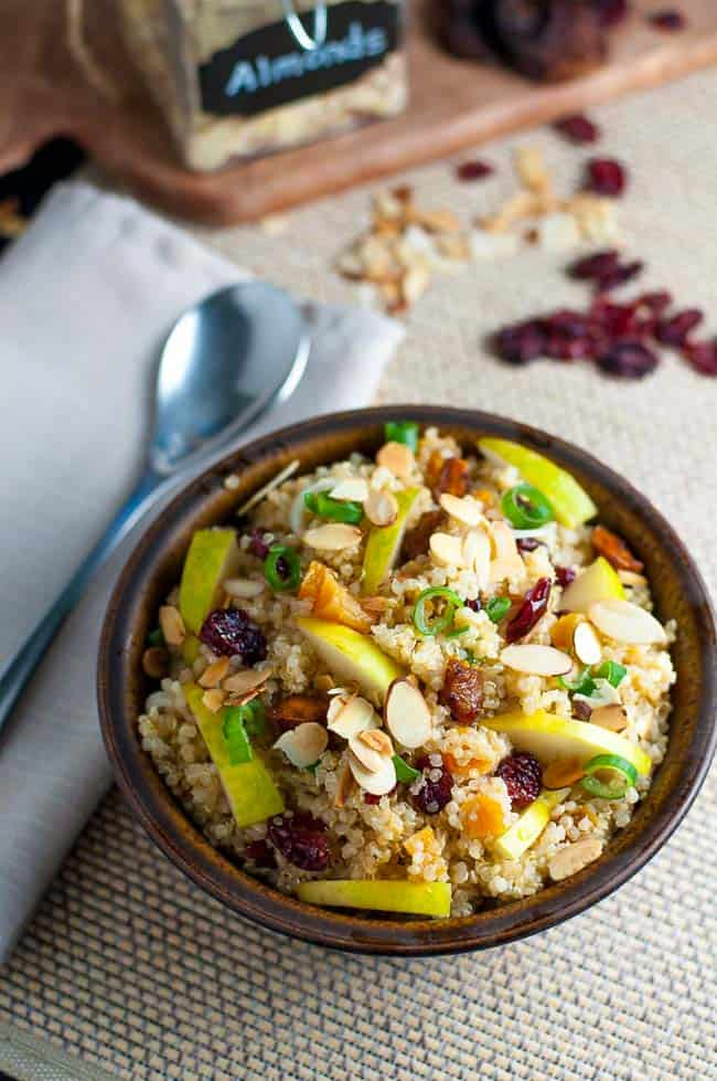 Nourishing Quinoa Salad with Cranberries and Pears. Make this gluten-free quinoa salad with cranberries and pears for a healthy lunch or a side dish. Perfect for a potluck! |www.flavourandsavour.com