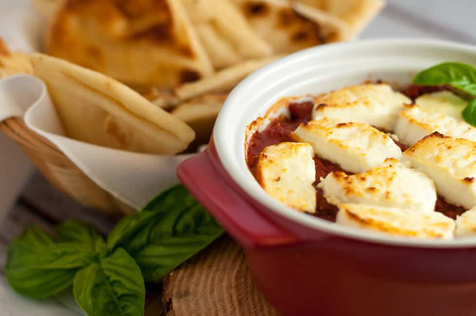 This simple Fire-Roasted Tomato Goat Cheese Dip makes a great appetizer or game-day snack. Gather your friends around the bowl and dip into this warm, comfort food appetizer or snack flavoured with garlic and herbs! |www.flavourandsavour.com