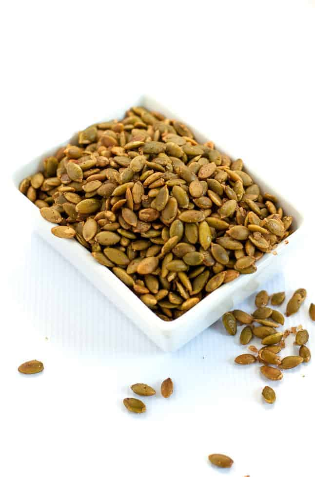 Spiced Pumpkin Seeds make a healthy snack, an addition to a cheese platter, or a garnish for soup or salad. They're mildly salty with a kick from chipotle peppers!  www.flavourandsavour.com