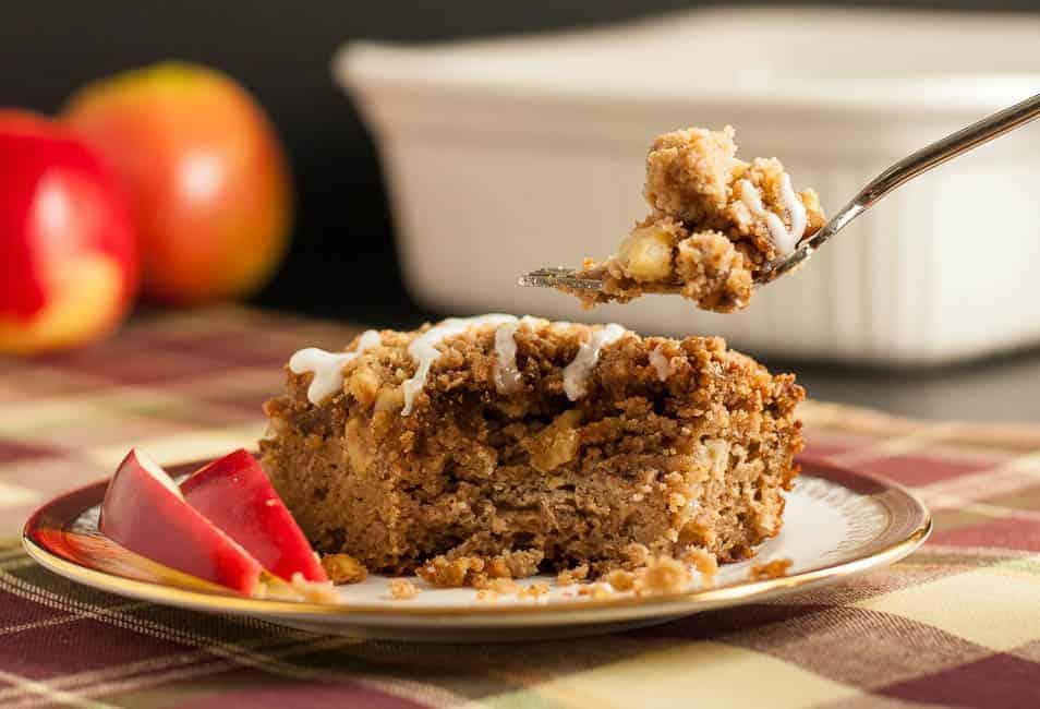 A slice of Gluten-Free Apple Cinnamon Coffee Cake with fresh apple slices