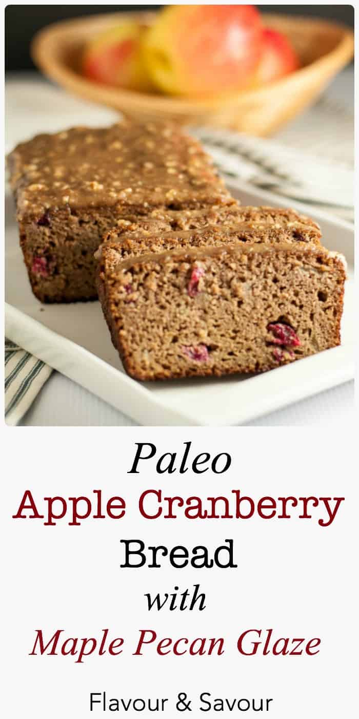 This Grain-Free Apple Cranberry Bread is tender and moist. It's topped with a naturally sweet glaze made from pecans, maple syrup and coconut oil. A healthy paleo snack!  www.flavourandsavour.com