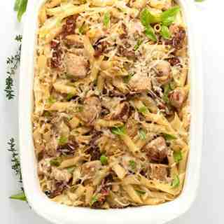 This Sun-dried Tomato Artichoke Penne Pasta has robust Italian flavours of tomatoes, artichokes, garlic and Parmesan cheese, all in one gluten-free pasta and chicken dish!