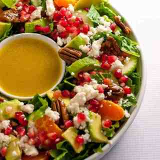 Holiday Wreath Salad. This Pomegranate Mandarin Salad with Avocado and Feta is beautiful when formed in a wreath shape. Perfect for holiday parties.