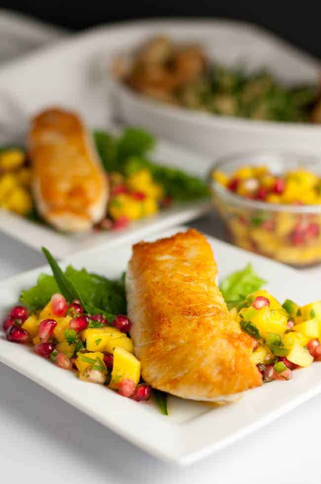 Salt and Pepper Crusted Halibut with Mango Pomegranate Salsa. Here's a quick way to sear halibut and guarantee it stays moist. This is an easy weeknight meal that's spectacular enough for entertaining! Serve with a colourful salsa. |www.flavourandsavour.com