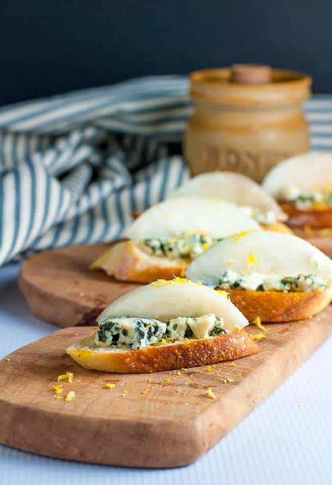 Blue Cheese Crostini with Crisp Honeyed Pear. Top thin slices of toasted baguette with blue cheese, a slice of crisp pear, a sprinkle of lemon zest and a drizzle of honey for a last-minute appetizer. |www.flavourandsavour.com