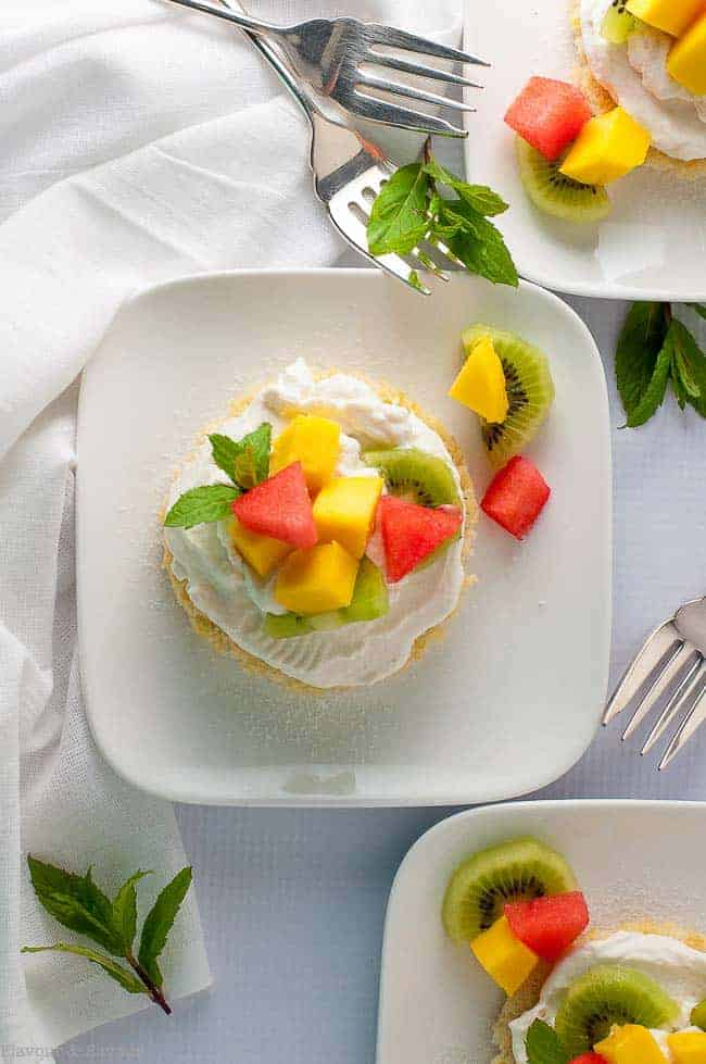 Here's a Gluten Free Lemon Fruit Flan in mini size! Individual lemon cakes topped with whipped cream and fresh fruit make a dessert you'll want to make again and again!