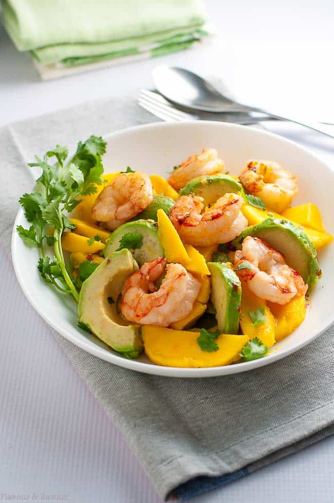 This fresh Prawn Mango Avocado Salad with sizzling shrimp can be on your dinner table in fifteen minutes. Sweet, juicy mangos, creamy avocado and tender shrimp all tossed with a lemon-lime dressing make a simple but simply delectable spring salad.