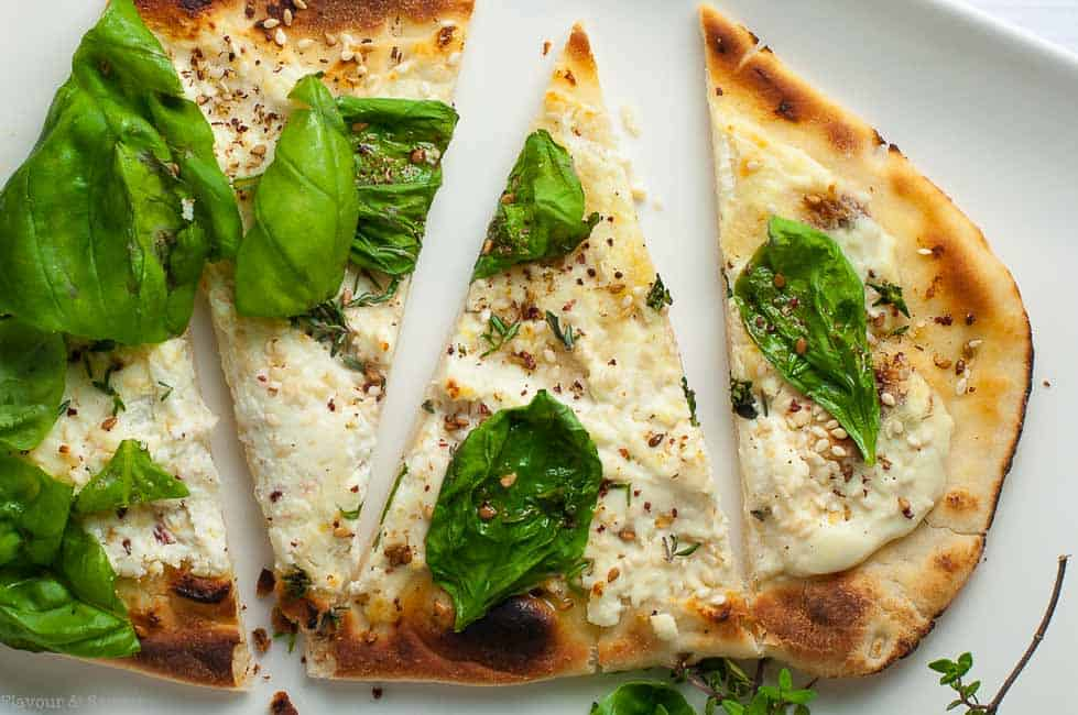 Whipped Goat Cheese Sesame Flatbread with Za'atar with fresh basil.