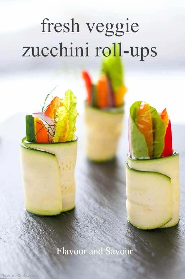 These Fresh Veggie Zucchini Roll-Ups are crisp, crunchy and flavoured with Caesar-flavoured cream cheese. They're a perfect party appetizer or healthy snack for kids. #raw #zucchini #appetizer #partysnack #rolls #healthy_snack #ad #sponsored