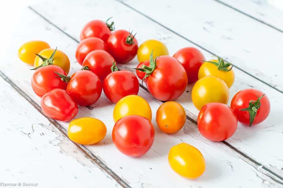 Cherry Tomatoes for Heirloom Tomato Salad with Basil, Capers and Feta on a white background