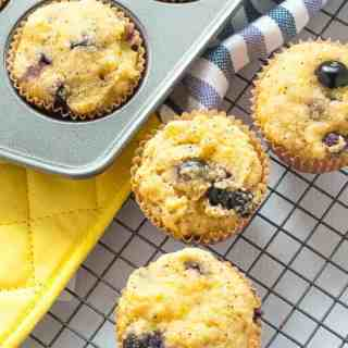 Paleo Blueberry Lemon Poppy Seed Muffins cooling on a rack.