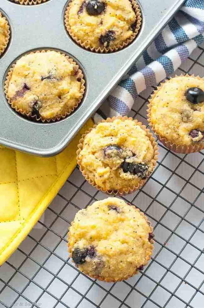 Paleo Blueberry Lemon Poppy Seed Muffins cooling on a rack. One of 15 Spring Brunch Recipe Ideas by Flavour and Savour