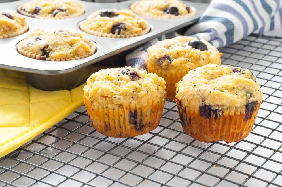 These Paleo Blueberry Lemon Poppyseed Muffins are made with almond flour, honey, and fresh blueberries. They're light and lemony!