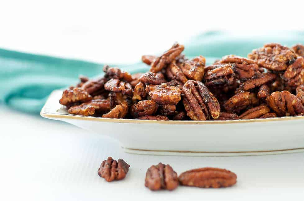 Close-up view of 20-minute Caramel Spiced Pecans with chipotle spice