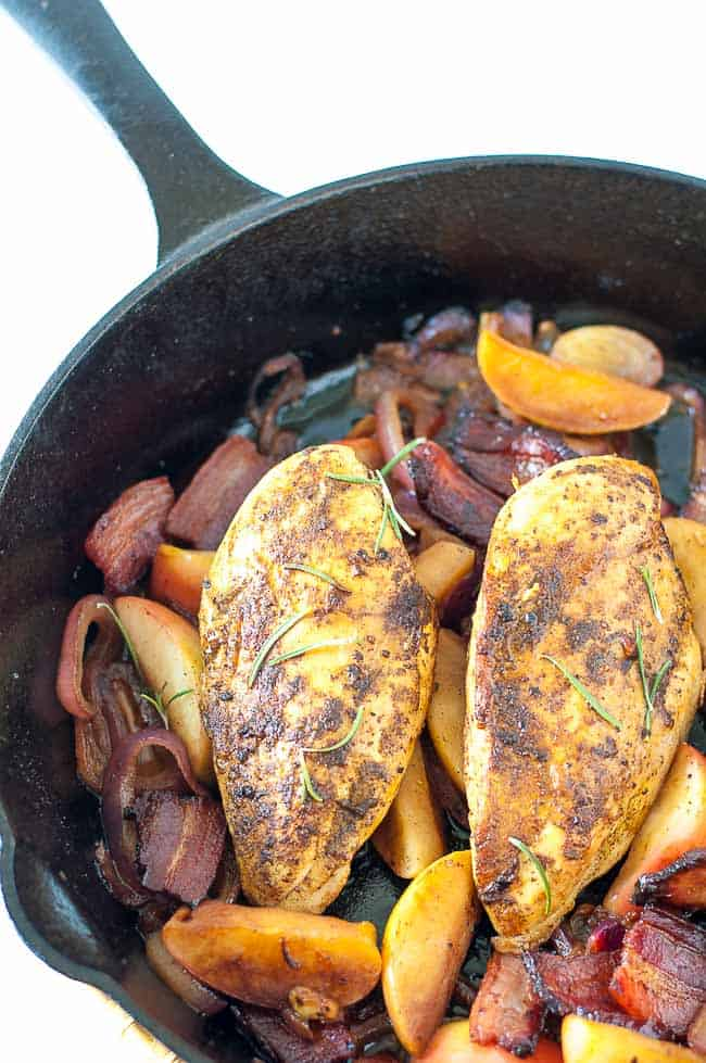 This One-Pan Spiced Apple Chicken with Bacon and Onions is sweet and smoky, tender and juicy! Perfect for a fall or winter dinner.