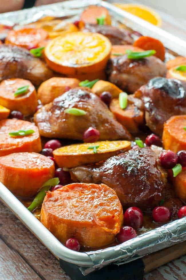 Hoisin Orange Sheet Pan Chicken with sliced oranges and cranberries
